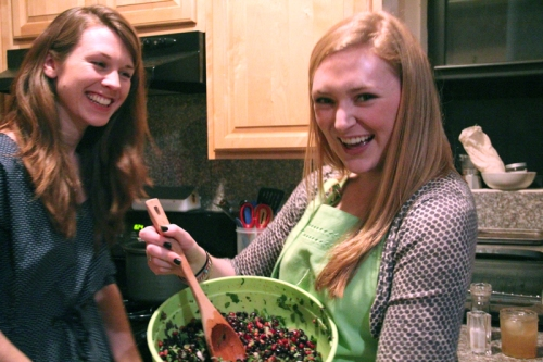 My roommates help prepare the black bean salad.